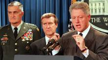 U.S. President Bill Clinton speaks during a 1998 press conference at the White House in Washington with Chairman of the Joint Chiefs of Staff, General Hugh Shelton, and Secretary of Defense William Cohen. (William Philpott/AFP)