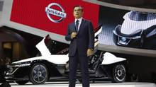 Nissan CEO Carlos Ghosn speaks in front of the company's BladeGlider EV concept car during a presentation at the 43rd Tokyo Motor Show in Tokyo on Nov. 20, 2013. (Toru Hanai/REUTERS)