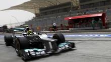 Mercedes Formula One driver Nico Rosberg of Germany drives in the pit lane during the third practice session of the Bahrain F1 Grand Prix at the Sakhir circuit in Manama April 21, 2012. (DARREN WHITESIDE/REUTERS)