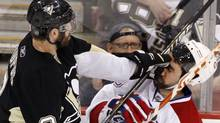 Pittsburgh Penguins' Pascal Dupuis (9) collides with Montreal Canadiens' Ryan O' Byrne during the first period of Game 1 of a second-round NHL playoff hockey game in Pittsburgh, Friday, April 30, 2010. (AP Photo/Gene J. Puskar) (Gene J. Puskar)