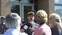 RCMP Staff Sergeant Kevin A. Baillie speaks to reporters outside the provincial RCMP headquarters in Charlottetown, P.E.I. (Nathan Rochford/The Canadian Press)