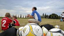 Coach David Hilgendorff allowed clapping from the sidelines, but not cheering or yelling, at Wednesday's game of the Aurora Youth Soccer house league in Aurora, Ont. (J.P. Moczulski for The Globe and Mail)