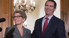 Outgoing Ontario Premier Dalton McGuinty, right, and incoming premier Kathleen Wynne pose for media after a meeting at the Queen's Park in Toronto on Monday, January 28, 2013. (Chris Young/THE CANADIAN PRESS)