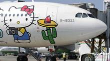 An Airbus A330-300 aircraft of Taiwan's Eva Airlines is seen with Hello Kitty motifs in Taoyuan International Airport, northern Taiwan, April 30, 2012. (PICHI CHUANG/PICHI CHUANG/REUTERS)