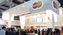 Attendees visit the MasterCard stand during the first day of the Mobile World Congress, on Monday, Feb. 22, 2016, in Barcelona, Spain. (Carlos Alonso/AP IMAGES FOR MASTERCARD)