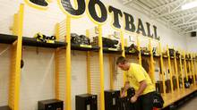 Player Brad Morton packs his bag in the dressing room after a press conference by the football players of the University of Waterloo Warriors football team. The school's football program was suspended for one year following a steroid investigation, Waterloo, Ontario, Thursday, June 17, 2010. (DAVE CHIDLEY/THE CANADIAN PRESS)
