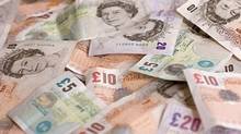 A mixture of colourful Pound notes (Sterling) laid out. (Rob Hill/iStockphoto)