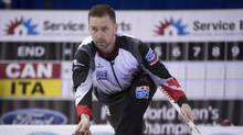 Canada skip Brad Gushue makes a shot during the 15th draw against Italy at the Men's World Curling Championships in Edmonton, Thursday, April 6, 2017. (JONATHAN HAYWARD/THE CANADIAN PRESS)