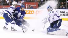 Toronto Maple Leafs center Auston Matthews tries to re-direct a shot as he goes to the next against the Tampa Bay Lightning at the Air Canada Centre, on April 6, 2017. (Tom Szczerbowski/USA Today Sports)