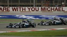 Mercedes driver Lewis Hamilton of Britain steers his car in front of his teammate Mercedes driver Nico Rosberg of Germany during the Bahrain Formula One Grand Prix at the Formula One Bahrain International Circuit in Sakhir, Bahrain, April 6, 2014. (Kamran Jebreili/AP)