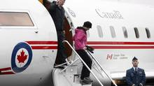Prime Minister Stephen Harper and his wife, Laureen, arrive at the Shell Aerocentre in North Saanich, B.C., during his Western tour. (CHAD HIPOLITO/THE CANADIAN PRESS)