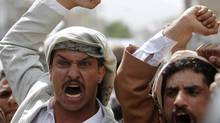 Protesters shout slogans during a protest on a road leading to the U.S. embassy in Sanaa September 21, 2012. They were protesting against an anti-Islam film made in the U.S. mocking the Prophet Mohammad. (Khaled Abdullah/REUTERS)