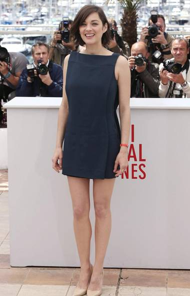 Marion Cotillard was among the many actresses and actors posing for photographers at the Cannes Film Festival in Cannes over the long weekend. She was there on Monday to promote the film Blood Ties. (Joel Ryan/Reuters)