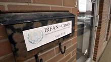 "An RCMP letter taped to the front door of the offices of the International Relief Fund for the Afflicted and Needy - Canada (IRFAN) states that the charity has been classifed as a ""terrorist group"" and its assests frozen, in a strip plaza in Mississauga, April 29, 2014. (J.P. MOCZULSKI for The Globe and Mail)"