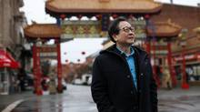 Canadian composer Chan Ka Nin, in front of the Gate of Harmonious Interest in Victoria, B.C. (CHAD HIPOLITO/THE GLOBE AND MAIL)