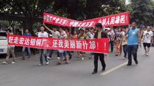 Local residents march with banners during a protest along a street in Shifang, Sichuan province. Residents in Shifang, a city in southwest China, took to the streets for a third day on Tuesday, demanding the government scrap plans for a copper alloy project they fear will poison them, in the latest unrest spurred by environmental concerns. (Stringer/Reuters)