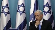 Israel's Prime Minister Benjamin Netanyahu sits after delivering a statement in Jerusalem November 21, 2012. (BAZ RATNER/REUTERS)
