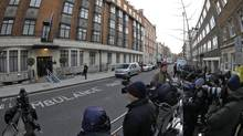 Media gather outside the King Edward VII hospital in central London where Catherine, the Duchess of Cambridge has been admitted with a severe form of morning sickness, Dec. 4, 2012. (Sang Tan/AP)