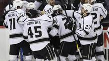 Los Angeles Kings celebrate after beating the New Jersey Devils 2-1 in overtime in Game 2 of the NHL hockey Stanley Cup finals Saturday, June 2, 2012 Üin Newark, N.J. (Kathy Willens/AP)