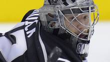 Los Angeles Kings goalie Jonathan Quick deflects a shot during the first period of Game 3 of the NHL hockey Stanley Cup Western Conference finals against the Phoenix Coyotes, Thursday, May 17, 2012, in Los Angeles. (AP Photo/Mark J. Terrill) (Mark J. Terrill)
