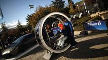 TEST DRIVE: A man steers a driving simulator at an event promoting the Sony PlayStation game Gran Turismo 6 in Ronda, Spain. (JON NAZCA/REUTERS)