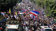 Thai anti-government protesters fill a street during a rally in Bangkok, Thailand Friday, Dec. 20, 2013. (Apichart Weerawong/AP)