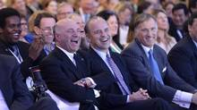 Kevin O'Leary, Rick Peterson and Maxime Bernier laugh during a Conservative Party leadership debate at the Manning Centre conference, on Friday, Feb. 24, 2017 in Ottawa. THE CANADIAN PRESS/Justin Tang (Justin Tang/THE CANADIAN PRESS)