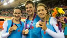Canada's Trar Whitten, left to right, Gillian Carleton and Jasmin Glaesser celebrate a bronze medal in the women's pursuit during the 2012 Summer Olympics in London on Saturday, August 4, 2012. (CP)