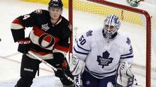 Toronto Maple Leafs' goalie Jonas Gustavsson and Ottawa Senators' Colin Greening follow the puck during the second period of their NHL hockey game in Ottawa October 30, 2011. (BLAIR GABLE/REUTERS)