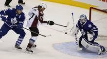 Colorado Avalanche forward Steve Downie (17) tries to deflect a puck on Toronto Maple Leafs goaltender Jonathan Bernier (45) as defenseman Dion Phaneuf (3) defends during the first period at the Air Canada Centre. (John E. Sokolowski/USA TODAY Sports)