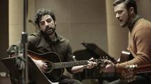 Oscar Isaac, left, and Justin Timberlake play Please Mr. Kennedy for the soundtrack of the Coen brothers' film Inside Llewyn Davis. (Alison Rosa/AP)