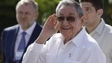 Cuban President Raul Castro, centre, cups his hand to his ear to better hear a reporter's question after a meeting with Russian Prime Minister Dmitry Medvedev in Havana on Feb. 22, 2013. (Franklin Reyes/The Associated Press)