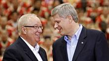 Canada's Prime Minister Stephen Harper shakes hands with former Montreal Canadiens coach Jacques Demers at Laval University in Quebec City Aug. 27, 2009. (MATHIEU BELANGER/REUTERS)