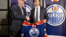 In this file photo, Edmonton Oilers general manager Craig MacTavish introduces the new head coach of the Edmonton Oilers, Dallas Eakins during a press conference in Edmonton, Alta., on Monday, June 10, 2013. MacTavish is standing behind coach Eakins despite his team's 4-14-2 start this season. (JASON FRANSON/THE CANADIAN PRESS)