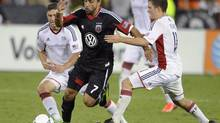 D.C. United midfielder Dwayne De Rosario during the second half of an MLS soccer game, Saturday, July 27, 2013, in Washington. D.C. United is parting ways with Canadian international De Rosario after declining to pick up its option on the 2011 Major League Soccer player of the year. (Nick Wass/THE CANADIAN PRESS)
