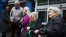 Residents Dorthy Pelletier, 86, right, and Kathleen Montgomery, 86, left, along with family members of other residents attend a news conference outside the Terraces on 7th retirement home in Vancouver. The facility has given notice to subsidized tenants that they must move out. (Rafal Gerszak For The Globe and Mail)