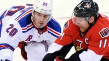 Ottawa Senators' Daniel Alfredsson fights for the puck with New York Rangers' Chris Kreider during the third period of game six of first round NHL Stanley Cup playoff hockey action at the Scotiabank Place in Ottawa on Monday, April 23, 2012. THE CANADIAN PRESS/Sean Kilpatrick (Sean Kilpatrick/CP)