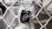 The NHL logo is seen on a goal at a Nashville Predators practice rink on Monday, Sept. 17, 2012, in Nashville, Tenn. (Mark Humphrey/AP)