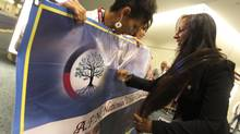Candidate Pamela Palmater signs a banner carried by her supporters. Ms. Palmater would have been the first female National Chief if she had been elected. The Assembly of First Nations (AFN) instead chose Shawn Atleo in Toronto on July 18, 2012. (Peter Power/The Globe and Mail)