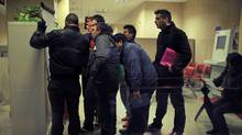 People look at the list of jobs in an employment office in Pamplona, northern Spain (Alvaro Barrientos/Alvaro Barrientos/AP)