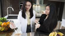 Angela Wang, left, and Madeleine Liu, both 16, are photographed in Vancouver on Saturday, Jan. 2, 2016. The 16-year-old students at West Point Grey Academy recently won the top prize at Startup Weekend Vancouver 2015 for their company called Culitech that will make utensils that use near-infrared spectrometers to read nutrients and allergens in food. (Rafal Gerszak For the Globe and Mail)