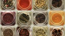 Arrangement of different herbs and spices in glass jars. (Jonathan Steven/iStockphoto)