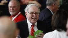 """Risk comes from not knowing what you're doing."" (Warren Buffett plays bridge with shareholders during a 2008 meeting.) (CARLOS BARRIA/REUTERS)"