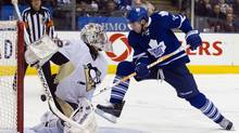 Toronto Maple Leafs Joffrey Lupul appears to score on Pittsburgh Penguins goalie Marc-Andre Fleury but the goal was disallowed after official review in the second period of their NHL hockey game in Toronto February 26, 2011. REUTERS/Fred Thornhill (FRED THORNHILL)