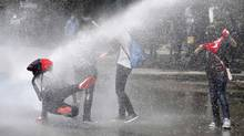 "Police use a water cannon against protesters during a demonstration in Ankara on June 3, 2013. Turkish Prime Minister Tayyip Erdogan accused anti-government protesters on Monday of walking ""arm-in-arm with terrorism,"" remarks that could further inflame public anger after three days of some of the most violent riots in decades. (UMIT BEKTAS/REUTERS)"