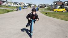 LANGDON, AB : MAY 21, 2015 -- 13-year-old Nick Wroblewsky a Grade 7 student plays on his scooter on the front street on Thursday, May 21, 2015 near Calgary, Alberta. His family doctor diagnosed him with situational anxiety, when he was eight and his parents found a tech-based therapy program with a counsellor in Newfoundland. Once a week, they would have phone therapy for a 10-week course to help him with is disorder. Photo by Chris Bolin for The Globe and Mail (Chris Bolin for The Globe and Mail)