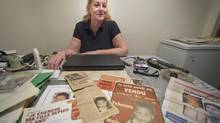Liliane Cyr in her apartment kitchen in Montreal Quebec, with press clippings about her missing child Yohanna, who went missing in 1978, Monday, April 21, 2014 (Peter Mccabe/THE GLOBE AND MAIL)