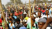 Miners gather for a march in Rustenburg, South Africa, Sept. 13, 2012. (SIPHIWE SIBEKO/REUTERS)