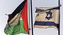 Israeli and Palestinian flags fly side by side in the West Bank town of Beit Jalla, near Bethlehem, in 2001. (LEFTERIS PITARAKIS/The Associated Press)