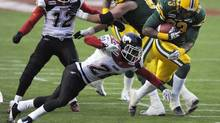 Edmonton Eskimos' Jerome Messam (R) crosses the goal line for a touchdown against Calgary Stampeders' Brandon Smith during their CFL Western semi-final game in Edmonton November 13, 2011. (DAN RIEDLHUBER/REUTERS)